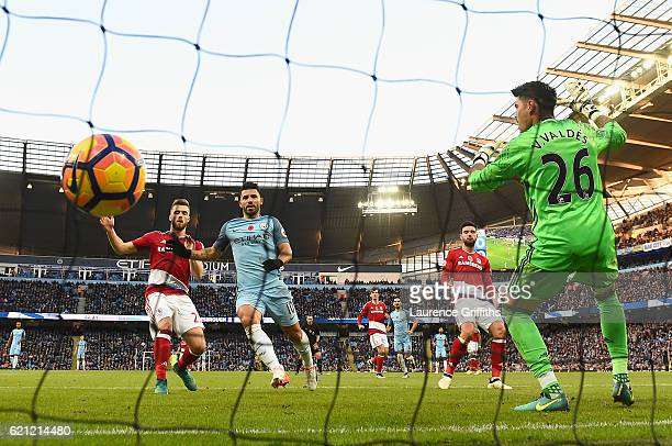 Sergio Aguero of Manchester City scores his sides first goal past Victor Valdes of Middlesbrough during the Premier League match between Manchester...