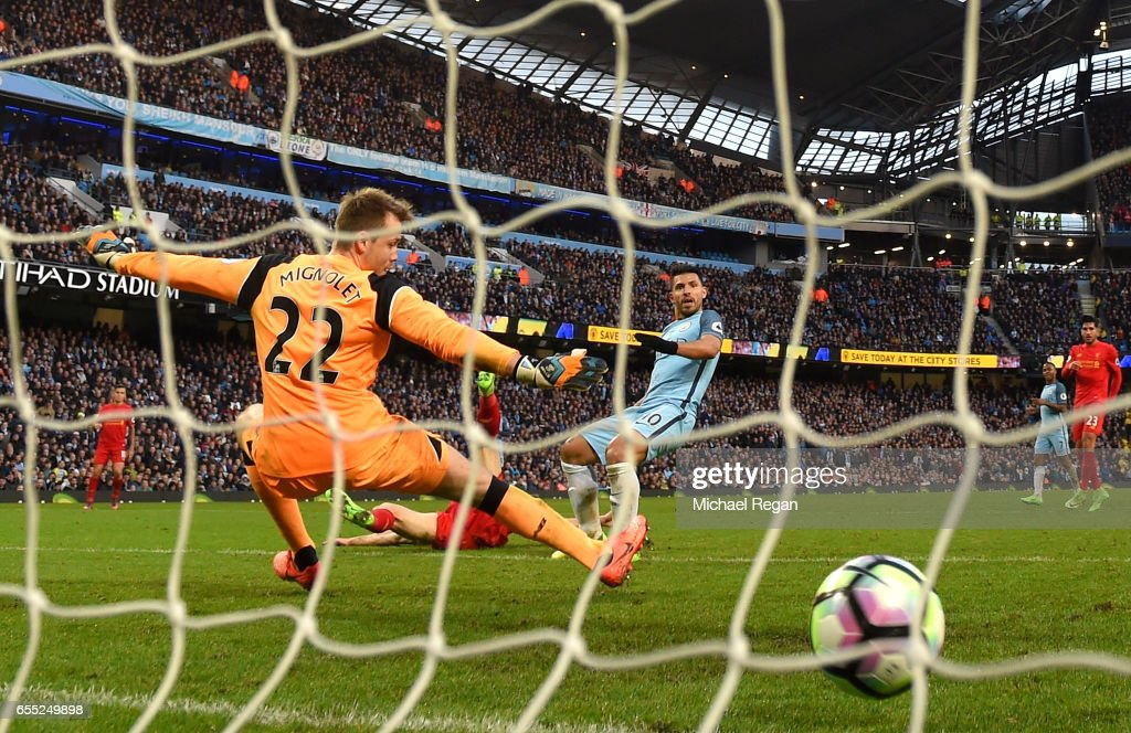 Sergio Aguero of Manchester City (R) scores his sides first goal past Simon Mignolet of Liverpool (L) during the Premier League match between Manchester City and Liverpool at Etihad Stadium on March 19, 2017 in Manchester, England.