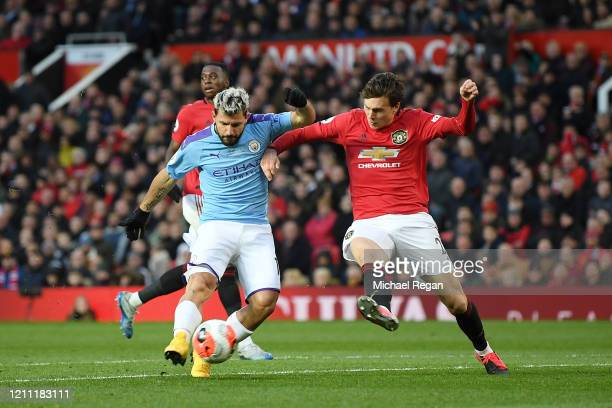Sergio Aguero of Manchester City scores his sides first goal which is later disallowed for being offside during the Premier League match between...