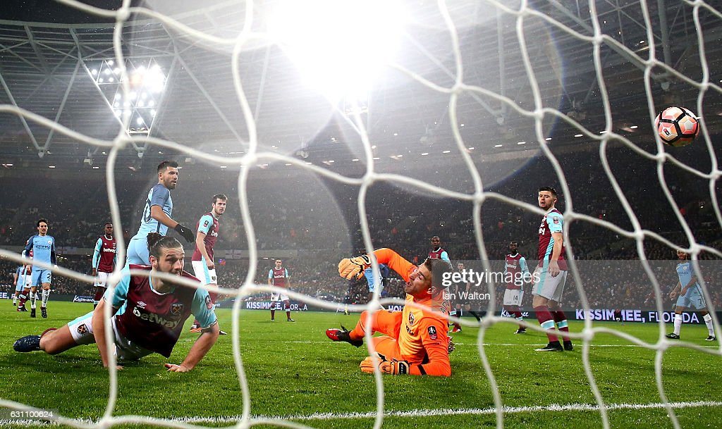 Sergio Aguero of Manchester City scores his sides fourth goal past Adrian of West Ham United during The Emirates FA Cup Third Round match between West Ham United and Manchester City at London Stadium on January 6, 2017 in London, England.