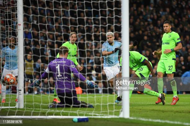 Sergio Aguero of Manchester City scores his sides second goal during the UEFA Champions League Round of 16 Second Leg match between Manchester City v...