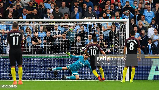 Sergio Aguero of Manchester City scores his sides second goal during the Premier League match between Swansea City and Manchester City at the Liberty...