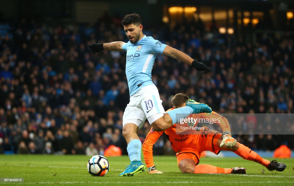 Sergio Aguero of Manchester City scores his sides second goal during The Emirates FA Cup Third Round match between Manchester City and Burnley at Etihad Stadium on January 6, 2018 in Manchester, England.