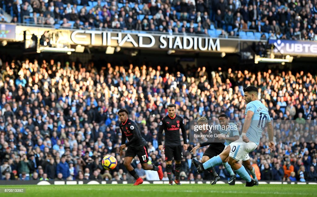 Sergio Aguero of Manchester City scores his sides second goal from the penalty spot during the Premier League match between Manchester City and Arsenal at Etihad Stadium on November 5, 2017 in Manchester, England.