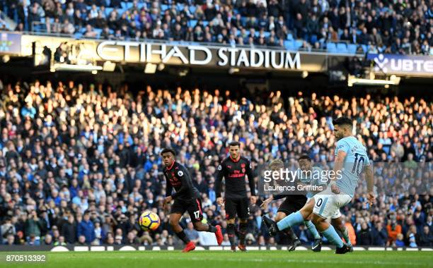Sergio Aguero of Manchester City scores his sides second goal from the penalty spot during the Premier League match between Manchester City and...