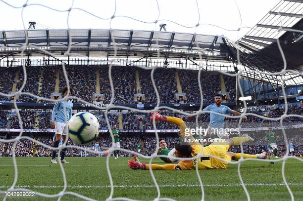 Sergio Aguero of Manchester City scores his sides second goal pass Mathew Ryan of Brighton and Hove Albion during the Premier League match between...