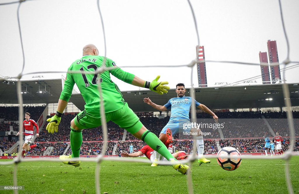 Sergio Aguero of Manchester City (C) scores his sides second goal past Brad Guzan of Middlesbrough (L) during The Emirates FA Cup Quarter-Final match between Middlesbrough and Manchester City at Riverside Stadium on March 11, 2017 in Middlesbrough, England.