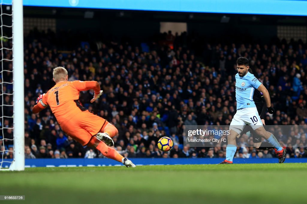 Sergio Aguero of Manchester City scores his side's second goal past Kasper Schmeichel of Leicester City during the Premier League match between Manchester City and Leicester City at Etihad Stadium on February 10, 2018 in Manchester, England.