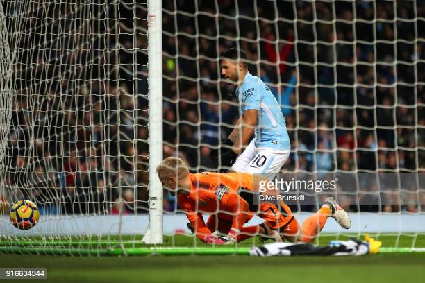 Sergio Aguero of Manchester City scores his side's second goal past Kasper Schmeichel of Leicester City during the Premier League match between...
