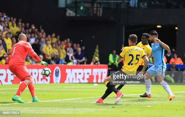 Sergio Aguero of Manchester City scores his sides third goal during the Premier League match between Watford and Manchester City at Vicarage Road on...