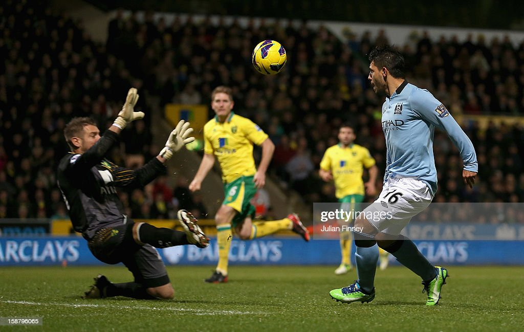 Sergio Aguero of Manchester City scores his side's third goal past Mark Bunn of Norwich City during the Barclays Premier League match between Norwich City and Manchester City at Carrow Road on December 29, 2012 in Norwich, England.
