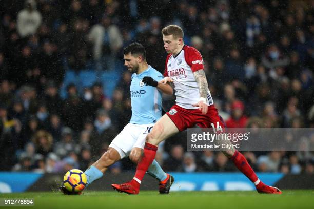 Sergio Aguero of Manchester City scores his sides third goal while under pressure from James McClean of West Bromwich Albion during the Premier...