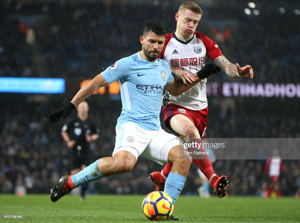 Sergio Aguero of Manchester City scores his sides third goal while under pressure from James McClean of West Bromwich Albion during the Premier League match between Manchester City and West Bromwich Albion at Etihad Stadium on January 31, 2018 in Manchester, England.
