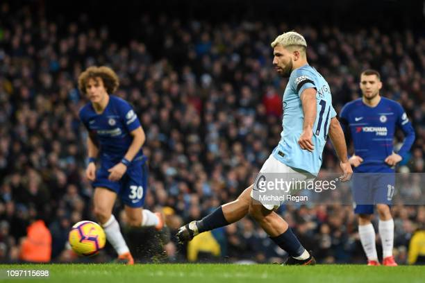 Sergio Aguero of Manchester City scores his team's fifth goal and his hatrick goal from the penalty spot during the Premier League match between...