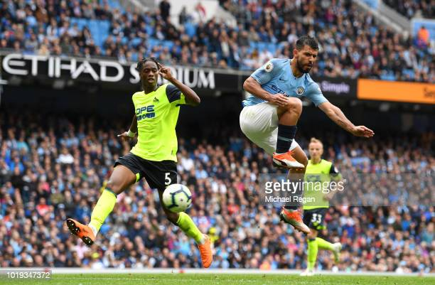 Sergio Aguero of Manchester City scores his team's fifth goal during the Premier League match between Manchester City and Huddersfield Town at Etihad...