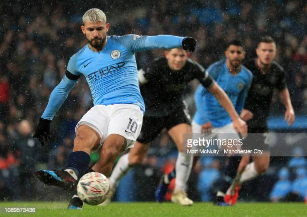 Sergio Aguero of Manchester City scores his team's fifth goal during the FA Cup Fourth Round match between Manchester City and Burnley at Etihad...