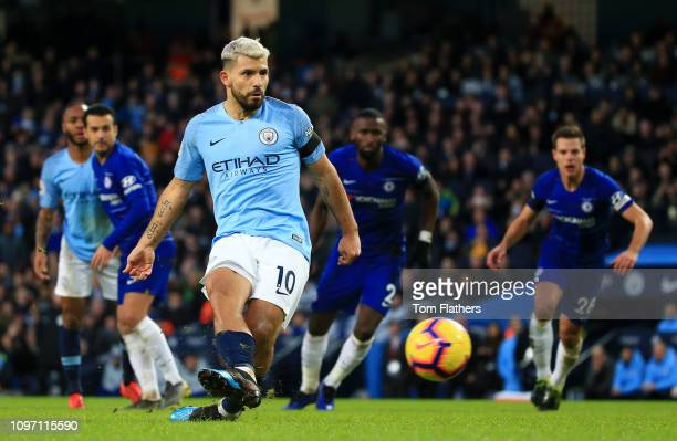 Sergio Aguero of Manchester City scores his team's fifth goal from the penalty spot during the Premier League match between Manchester City and...