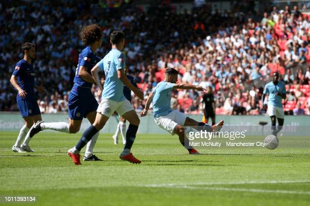Sergio Aguero of Manchester City scores his team's first goal during the FA Community Shield between Manchester City and Chelsea at Wembley Stadium...