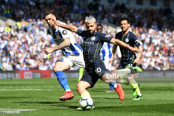 Sergio Aguero of Manchester City scores his team's first goal during the Premier League match between Brighton & Hove Albion and Manchester City at...