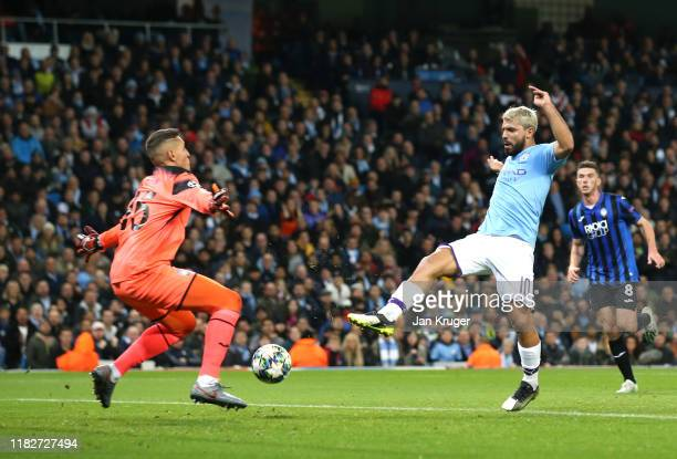Sergio Aguero of Manchester City scores his team's first goal during the UEFA Champions League group C match between Manchester City and Atalanta at...