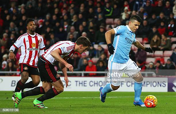 Sergio Aguero of Manchester City scores his team's first goal during the Barclays Premier League match between Sunderland and Manchester City at the...