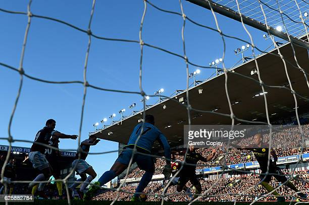 Sergio Aguero of Manchester City scores his team's first goal during the Premier League match between Burnley and Manchester City at Turf Moor on...