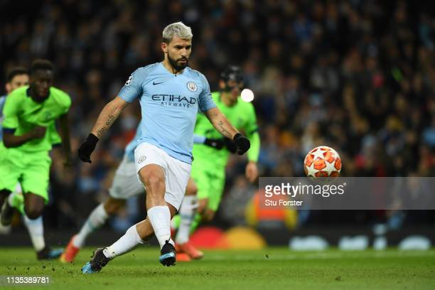Sergio Aguero of Manchester City scores his team's first goal from the penalty spot during the UEFA Champions League Round of 16 Second Leg match...