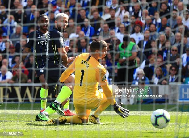 Sergio Aguero of Manchester City scores his team's first goal past Mathew Ryan of Brighton and Hove Albion during the Premier League match between...