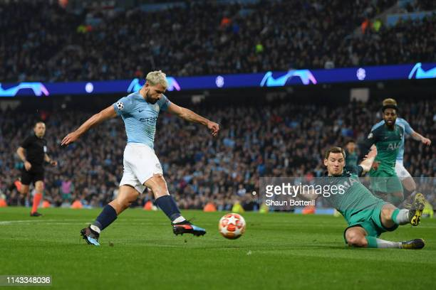 Sergio Aguero of Manchester City scores his team's fourth goal under pressure from Jan Vertonghen of Tottenham Hotspur during the UEFA Champions...