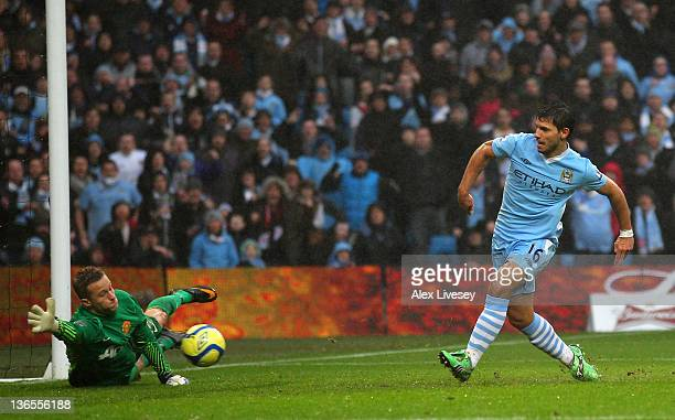 Sergio Aguero of Manchester City scores his team's second goal during the FA Cup Third Round match between Manchester City and Manchester United at...