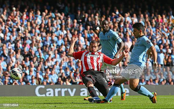 Sergio Aguero of Manchester City scores his team's second goal during the Barclays Premier League match between Manchester City and Sunderland at the...