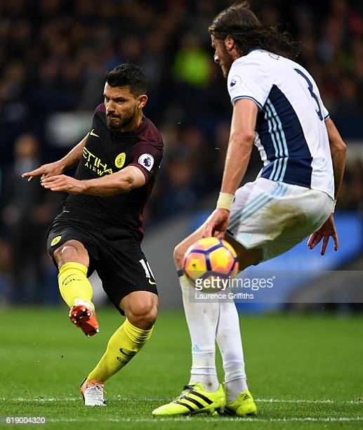 Sergio Aguero of Manchester City scores his team's second goal during the Premier League match between West Bromwich Albion and Manchester City at...