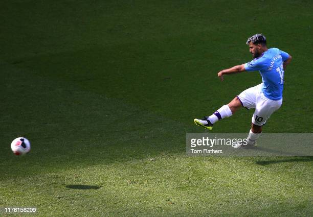 Sergio Aguero of Manchester City scores his teams second goal from the penalty spot during the Premier League match between Manchester City and...