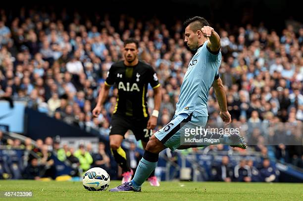 Sergio Aguero of Manchester City scores his team's second goal from the penalty spot during the Barclays Premier League match between Manchester City...