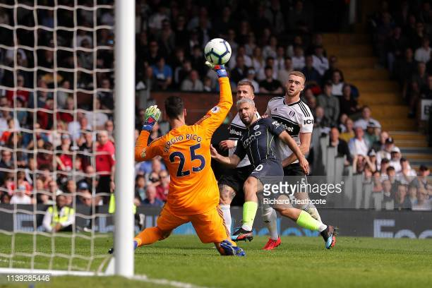 Sergio Aguero of Manchester City scores his team's second goal past Sergio Rico of Fulham during the Premier League match between Fulham FC and...