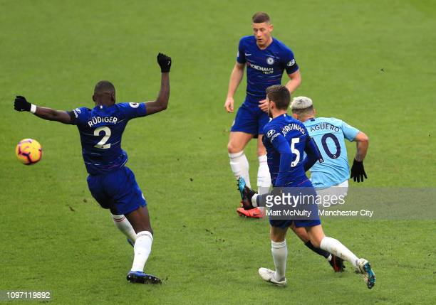 Sergio Aguero of Manchester City scores his team's second goal under pressure from Antonio Ruediger Jorginho and Ross Barkley of Chelsea during the...