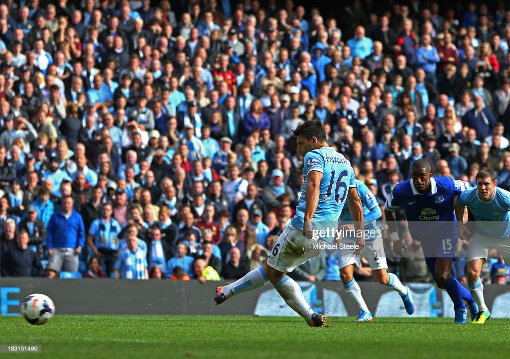 Sergio Aguero of Manchester City scores his team's third goal from the penalty spot during the Barclays Premier League match between Manchester City and Everton at Etihad Stadium on October 5, 2013 in Manchester, England.