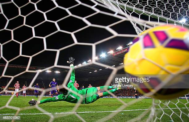 Sergio Aguero of Manchester City scores his team's third goal from the penalty spot past Asmir Begovic of Stoke City during the Barclays Premier...