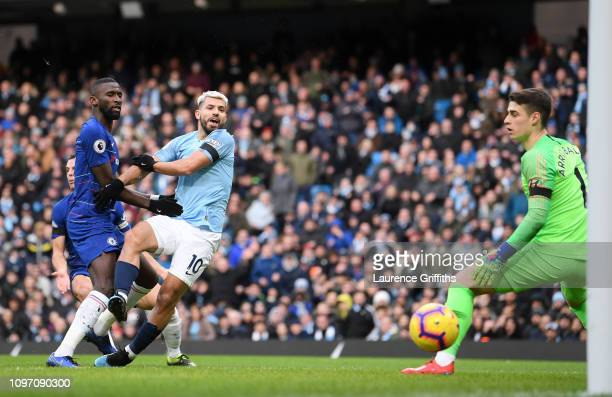 Sergio Aguero of Manchester City scores his team's third goal past Kepa Arrizabalaga of Chelsea during the Premier League match between Manchester...