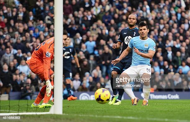 Sergio Aguero of Manchester City scores his team's third goal past goalkeeper Hugo Lloris of Tottenham Hotspur during the Barclays Premier League...