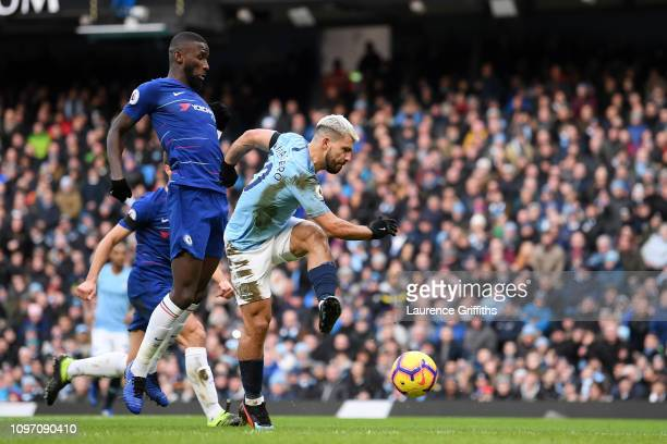 Sergio Aguero of Manchester City scores his team's third goal under pressure from Antonio Ruediger of Chelsea during the Premier League match between...
