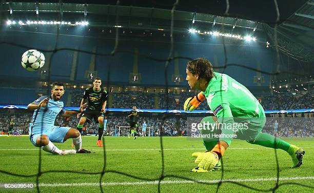 Sergio Aguero of Manchester City scores past Yann Sommer of Borussia Moenchengladbach during the UEFA Champions League match between Manchester City...