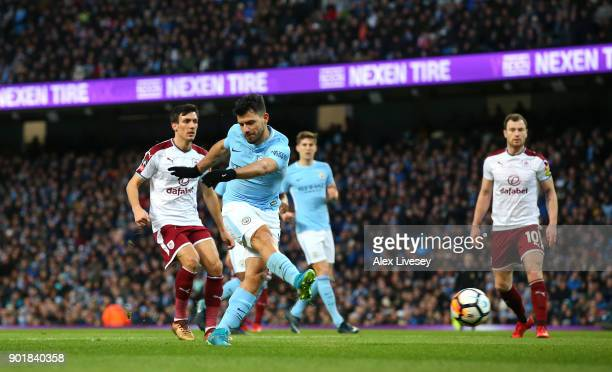 Sergio Aguero of Manchester City scores the first goal during The Emirates FA Cup Third Round match between Manchester City and Burnley at Etihad...