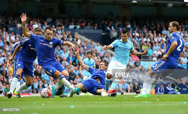 Sergio Aguero of Manchester City scores the opening goal during the Barclays Premier League match between Manchester City and Chelsea at Etihad...