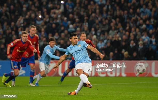 Sergio Aguero of Manchester City scores the opening goal from the penalty spot during the UEFA Champions League Group D match between Manchester City...