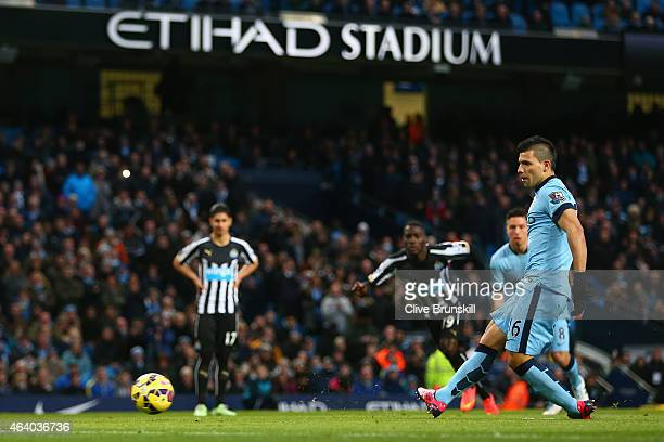 Sergio Aguero of Manchester City scores the opening goal from the penalty spot during the Barclays Premier League match between Manchester City and...