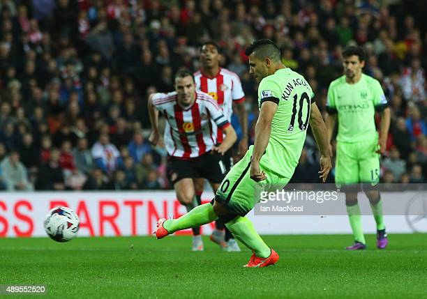 Sergio Aguero of Manchester City scores the opening goal from the penalty spot during the Capital One Cup third round match between Sunderland and...