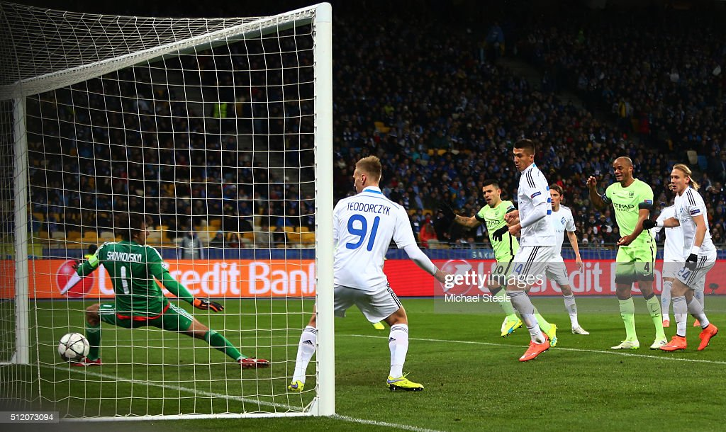 Sergio Aguero #10 of Manchester City scores the opening goal past goalkeeper Oleksandr Shovkovskiy of Dynamo Kiev during the UEFA Champions League round of 16, first leg match between FC Dynamo Kyiv and Manchester City FC at the Olympic Stadium on February 24, 2016 in Kiev, Ukraine.
