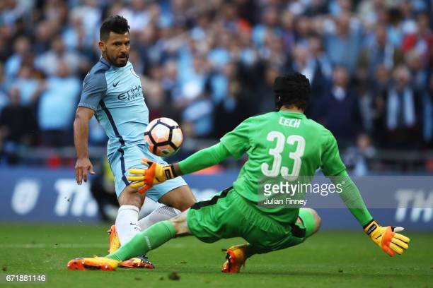 Sergio Aguero of Manchester City scores the opening goal past Petr Cech of Arsenal during the Emirates FA Cup SemiFinal match between Arsenal and...