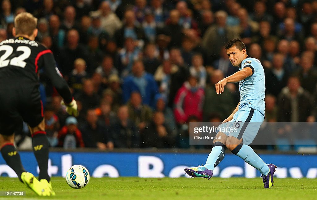 Sergio Aguero of Manchester City scores the third goal during the Barclays Premier League match between Manchester City and Liverpool at the Etihad Stadium on August 25, 2014 in Manchester, England.